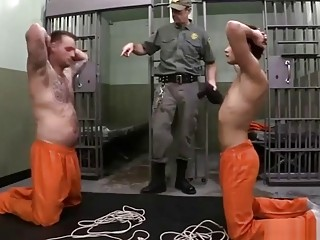 Prison guard tortures and dominates the new guy