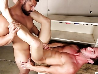 Athletic gay guys have hardcore gay sex in the garage