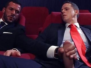 Hunks in suits strip for anal sex at the cinema