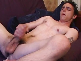 Needy young buck masturbates with a thick toy