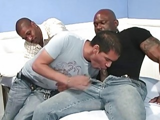 Gay slut gets to take on two hunky black dudes