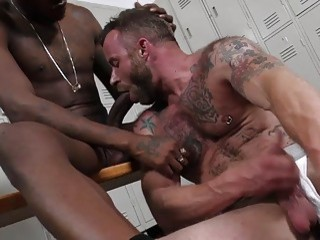 Having interracial anal sex in the locker room