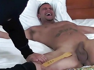 Dominated muscle man laughs until he cries
