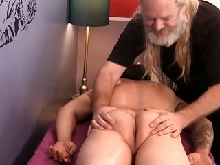 Old dude toys with a stud during a massage