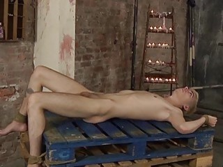 Submissive blonde twink teased with hot wax before throat fucking
