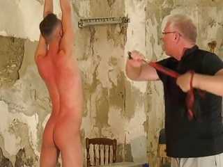 Twink tied up by an older man for gay BDSM