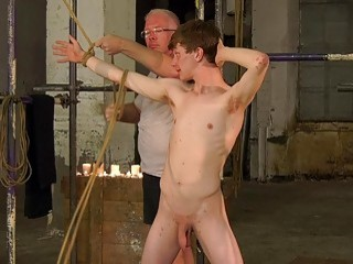 Submissive twink tied up by an older gay for domination