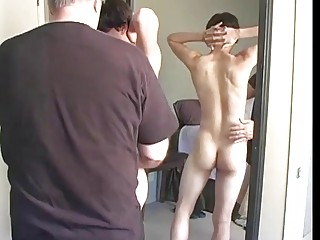 Daddy gives gay stepson a handjob until he cums