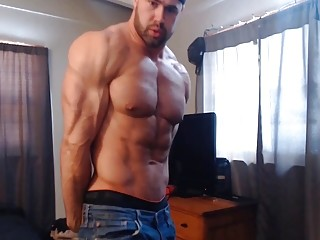 Hunk with muscles flexes his amazing body