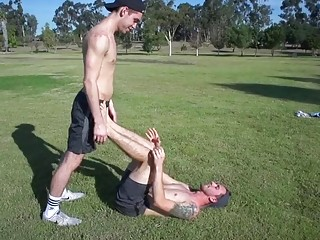 After stretching, two hunks take a break for satisfying anal sex