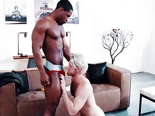 Muscled black guy rams this gay blonde's tight asshole