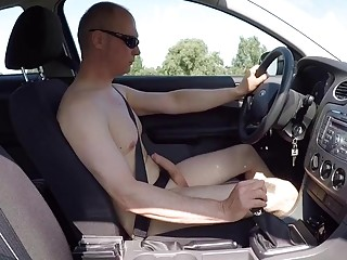 Pervy naked man drives around before finding a place to jerk off