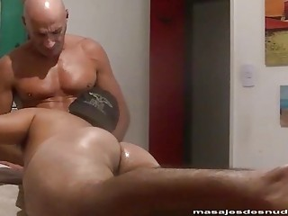 Masseuse uses his oiled up fingers to penetrate this guy's ass