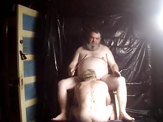 Big bear dominates his sloppy pig