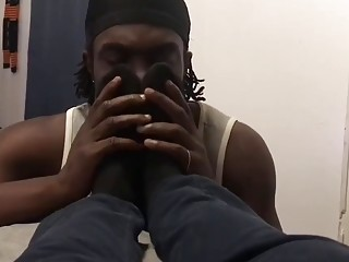 Black boi indulges in his sub's tasty feet