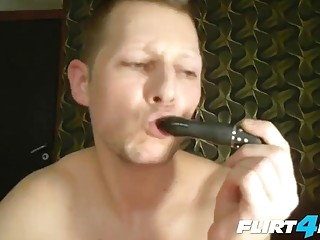 A small toy tickles his hole while he strokes