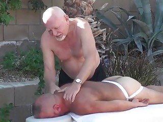Two daddies treat this young hunk to a massage and fuck
