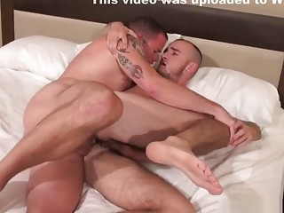 Tattooed gay couple go to bang town in the bedroom