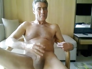 Older gentleman uses a toy while jerking off in a hotel room