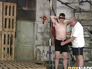 Young homo tied up while his master strokes his cock