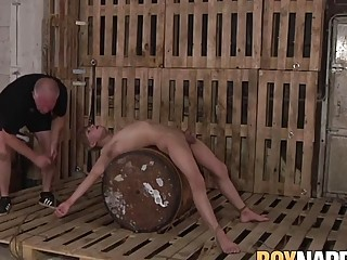 Submissive young guy tied up and pinched by his older master