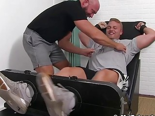 Bare feet hunk tickled and tormented